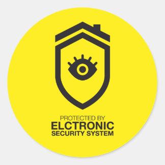 Skyddat av elektroniksäkerhetssystemet runt klistermärke