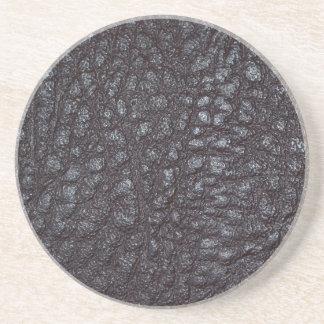 Slitet texturerat läder underlägg sandsten