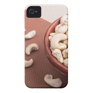 Slutet beskådar upp på rå cashewnöt för vegetarian iPhone 4 fodral