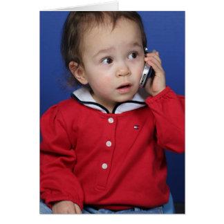 Småbarn på celltelefonen hälsningskort