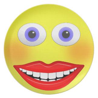 Smileyen som är kvinnlig med den stora le tallrik