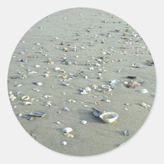 Snäckor på den imperialistiska stranden, runt klistermärke