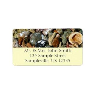 Snäckor, stenar och tema för korallstrandnatur adressetikett