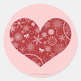 Snöflingor i hjärta runt klistermärke