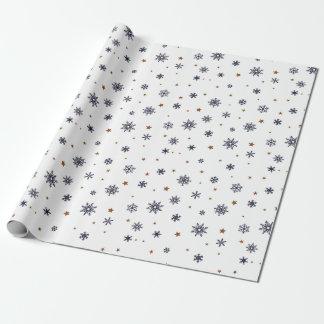 Snöflingor- och stjärnajul som slår in papper presentpapper