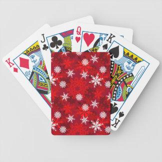 Snöflingor på röd bakgrund spelkort