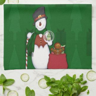 Snögubbe med en hänga lösfullt av presenter kökshanddukar