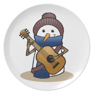 Snögubbe med gitarren tallrik