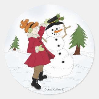 Snögubbe med liten flicka runt klistermärke