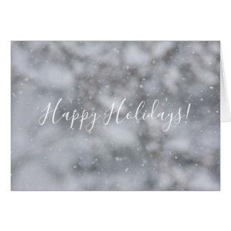 Snöig hälsning för julsnövintersnöflingor hälsningskort