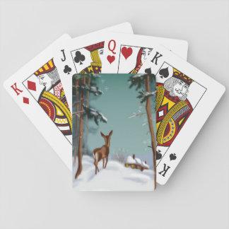 Snöig underland som leker kortet kortlek
