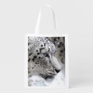 Snöleoparden profilerar i snö återanvändbar påse