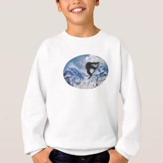 Snowboarder i flyg tröjor