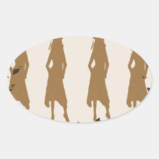 Solbränna och guld- akademikra flickaSilhouettes Ovalt Klistermärke
