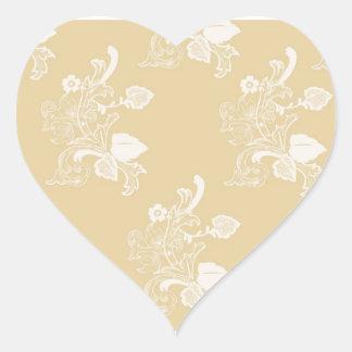 Solbränna- & vitvintageblommönster hjärtformat klistermärke
