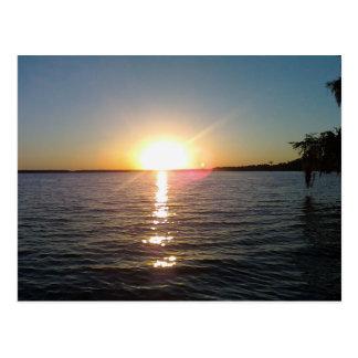 Solnedgång på flodarmen vykort