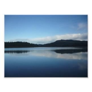 Solnedgång på sjön foton