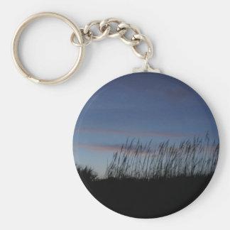 Solnedgång på stranden rund nyckelring