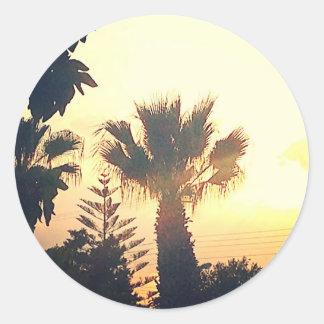 Solnedgång tropisk bild runt klistermärke