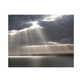 solnedgången regnar över hav canvastryck