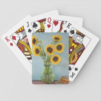 Solrosor i vas på bord casinokort