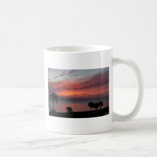 Soluppgång över hav kaffemugg