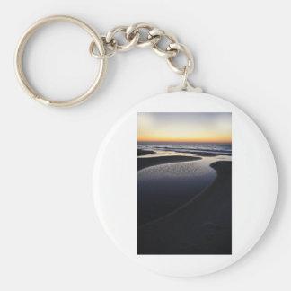 Soluppgång över hav rund nyckelring