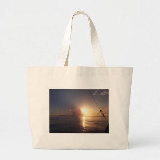 Soluppgång på hav tygkassar