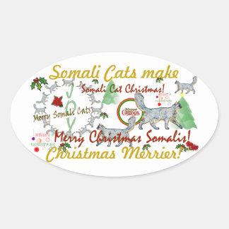 Somaliska katter gör jul mer glad ovalt klistermärke