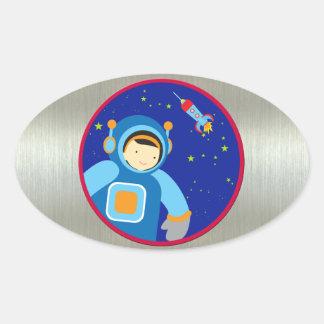 Spaceboy som flyter utanför spaceshipen ovalt klistermärke