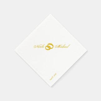 Spara datera - två flätade samman guld- ringar pappersservetter