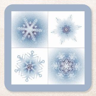 Sparkly blåttsnöflingor underlägg papper kvadrat