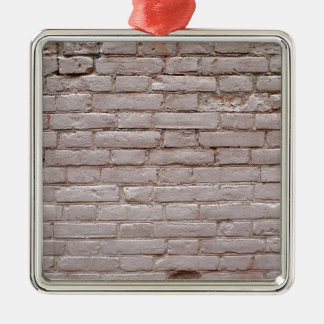Specificera av en vägg av de gammala beige julgransprydnad metall
