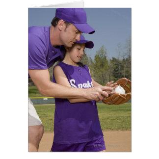 Spelare för lagledareundervisningbarnserien i hälsningskort