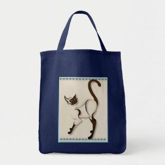 Stå Siamese kattunge hänger lös Tygkasse