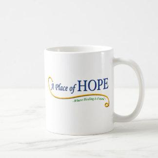 Ställe av hopplogotypen kaffemugg