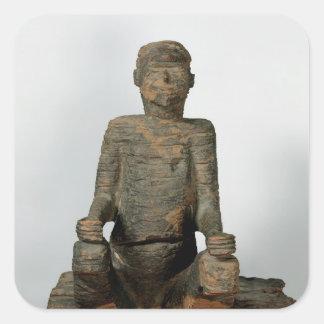 Staty av en placerad man, Mbembe, Nigeria Fyrkantigt Klistermärke
