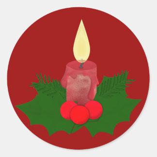 Stearinljus och järnekklistermärke runt klistermärke