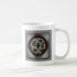 Stenar i bunke kaffemugg