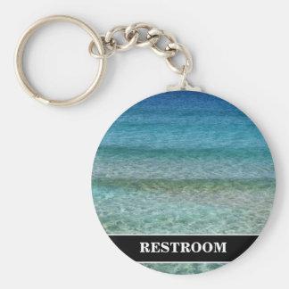 Stilla den vinkara bakgrundstoaletten för hav rund nyckelring
