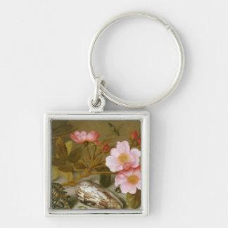 Stilleben som visar blommor fyrkantig silverfärgad nyckelring
