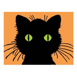 Stor grönögd svart katt med att svälla ut ögon vykort