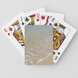 Strand som leker kort casinokort
