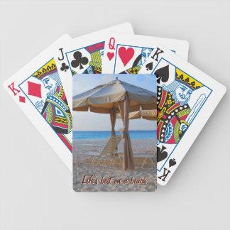 StrandCabanahav beskådar att leka kort Spelkort