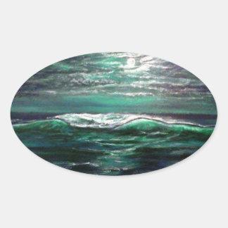 stranden vinkar månsken ovalt klistermärke