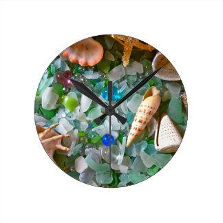 strandexponeringsglas med snäckor rund klocka
