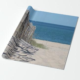 Strandstaketrollbesättning skuggar i sanden presentpapper
