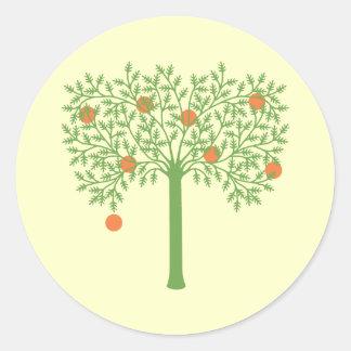 Stylized orange träd runt klistermärke