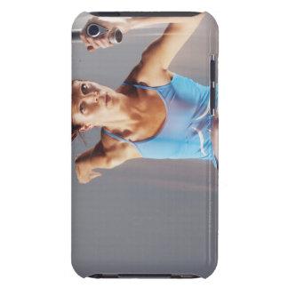 Suddigt beskåda av idrottsmanspring med taktpinnen iPod touch skydd