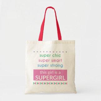Supergirl hänger lös budget tygkasse